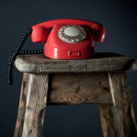 Red phone on stool