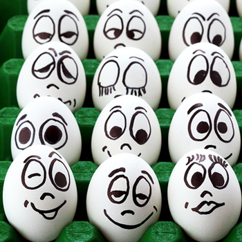 Eggs, with faces displaying various emotions painted on