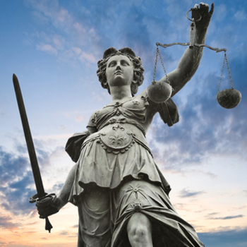 Statue of justice, holding scales