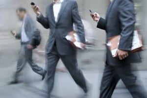 men in suits on their mobile phones