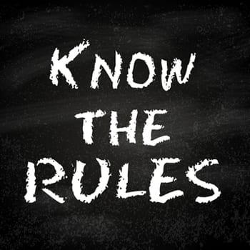 """Know the rules"" written on chalkboard"