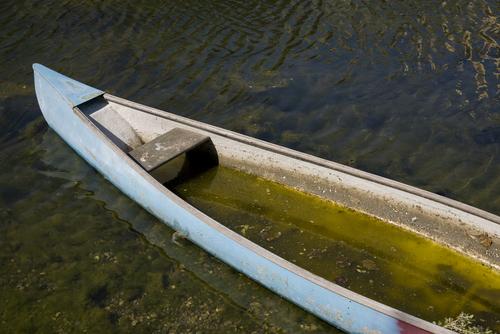 leaking boat in river
