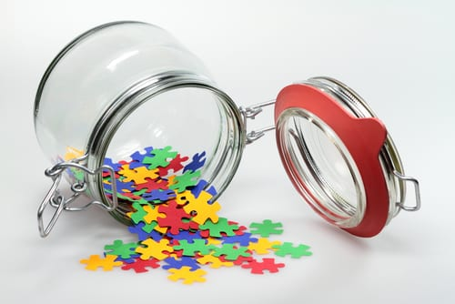 puzzle pieces coming out of a jar