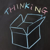 "Box and ""thinking"" drawn on chalkboard"