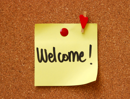 welcome on a post-it note on a pinboard