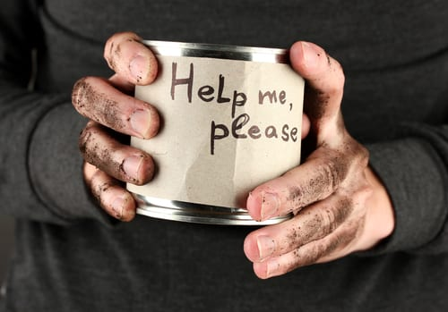hands holding a charity tin