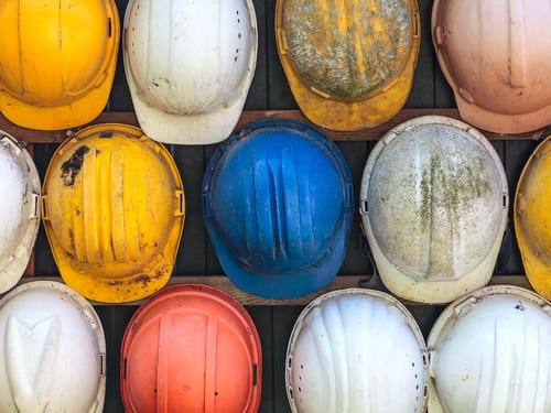 old work helmets hanging up