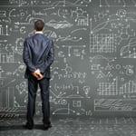 man in front of blackboard