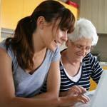 woman helping older woman